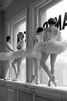 Ballerinas standing on window sill in rehearsal room at George Balanchine's School of American Ballet.